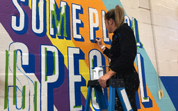 PWHS alum returns to paint a mural at Whitemarsh Elementary