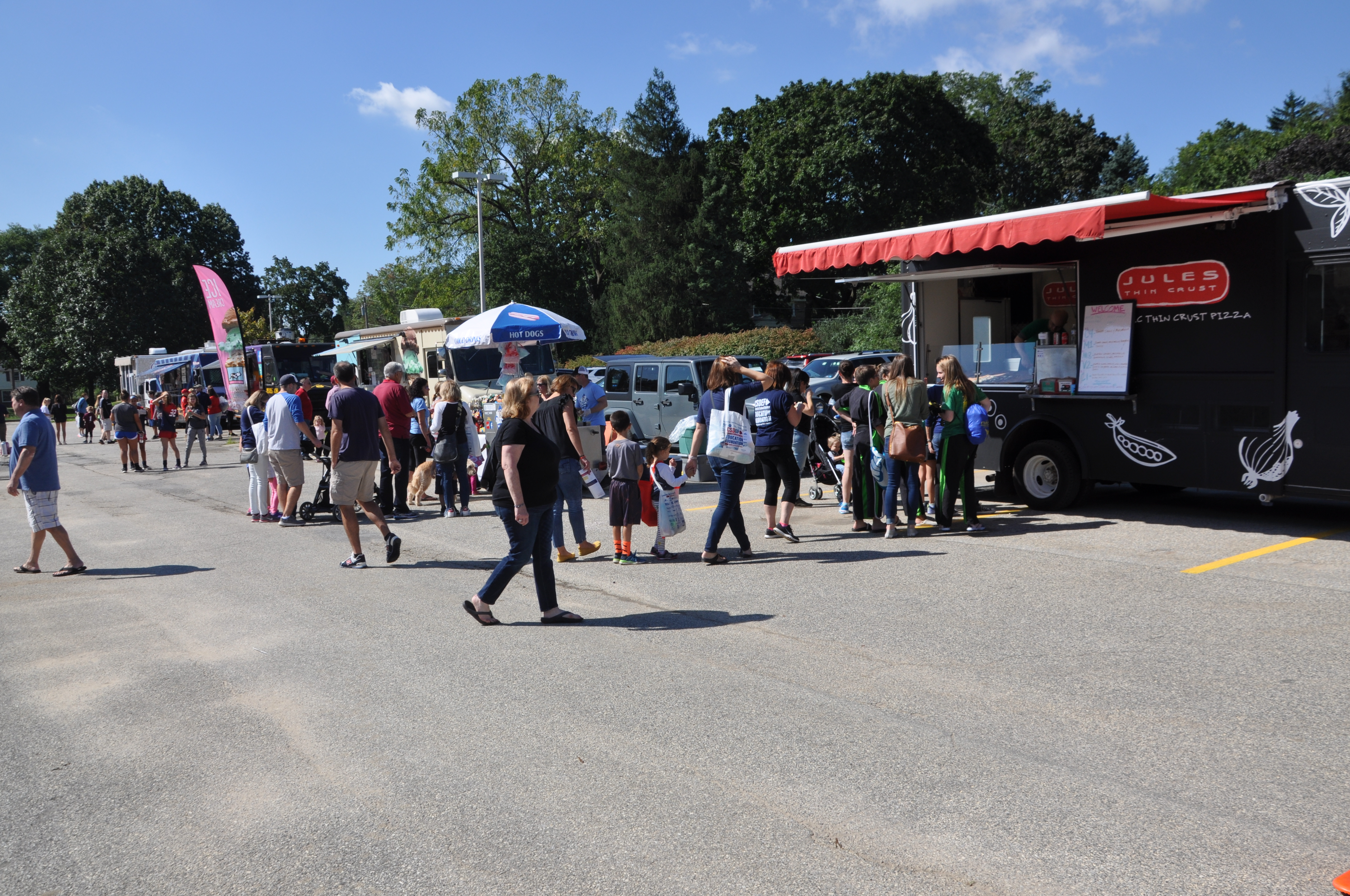 Several Food trucks with people lined up