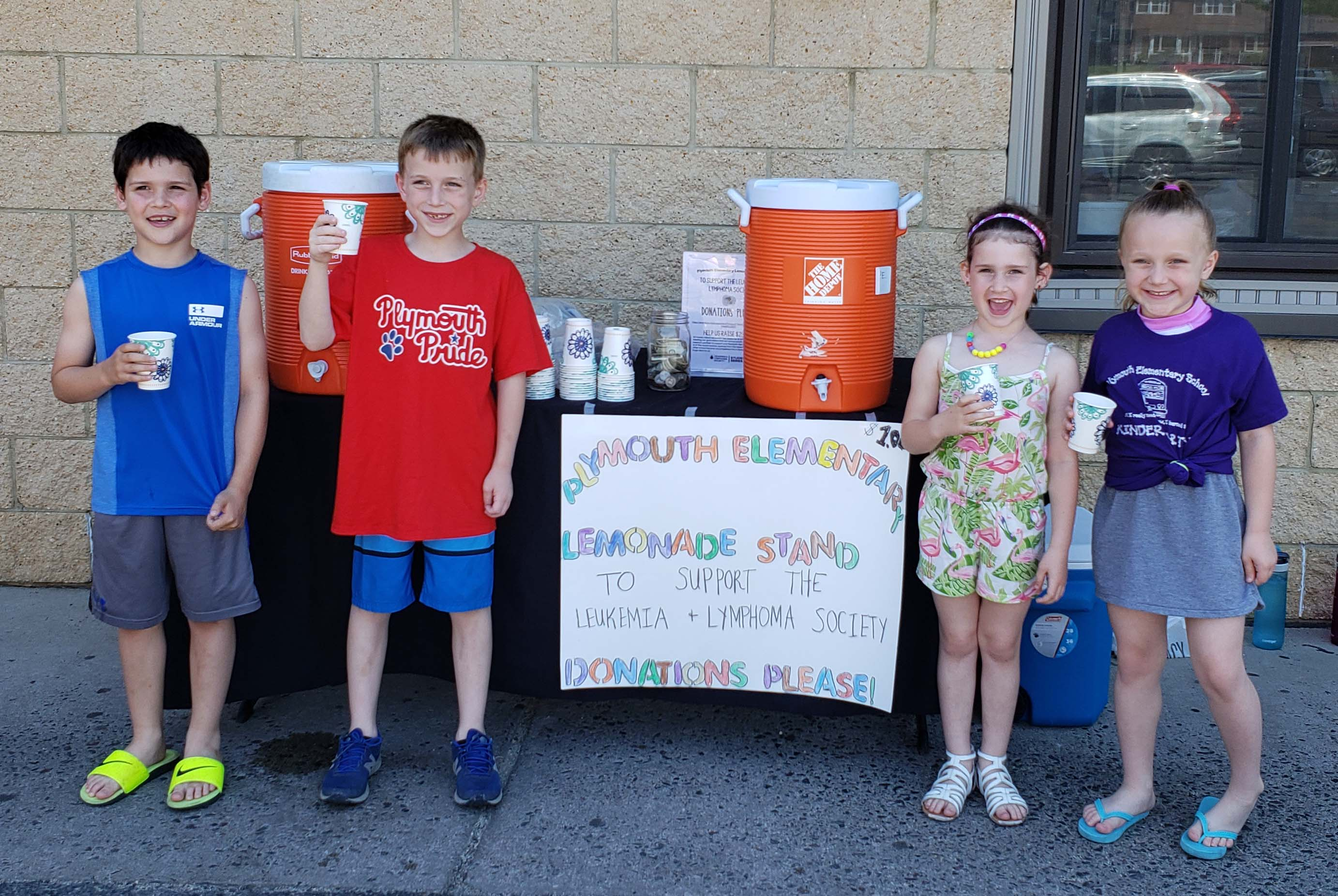 Four children at a lemonade stand