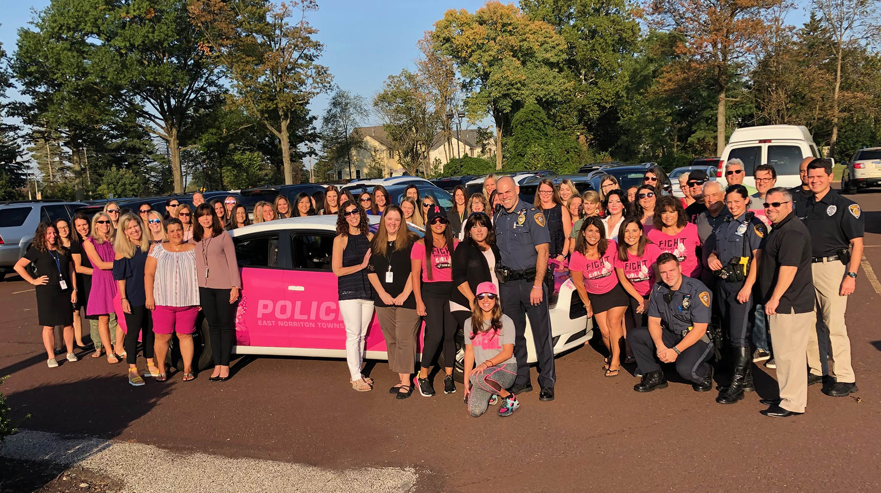 teachers and police officers with pink police car