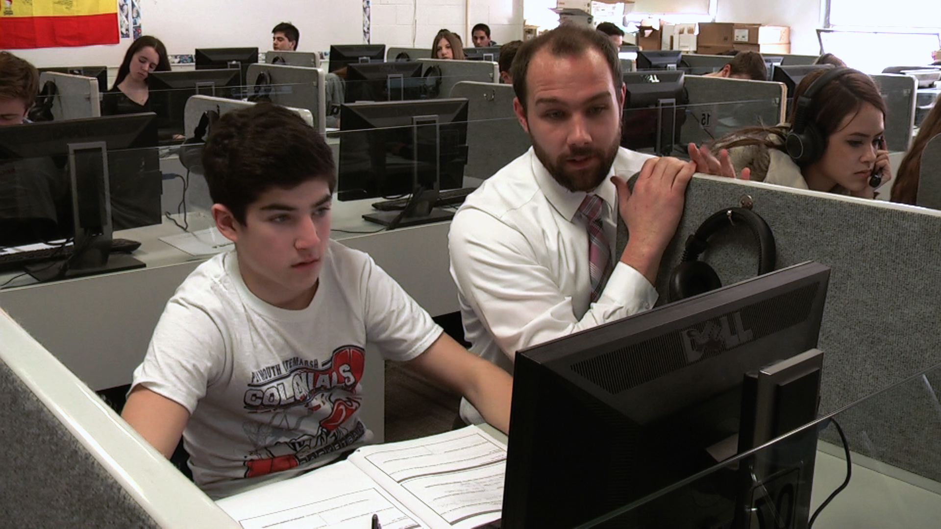 Plymouth Whitemarsh High School Master Teacher Rich Madel works with a student in his Spanish class.
