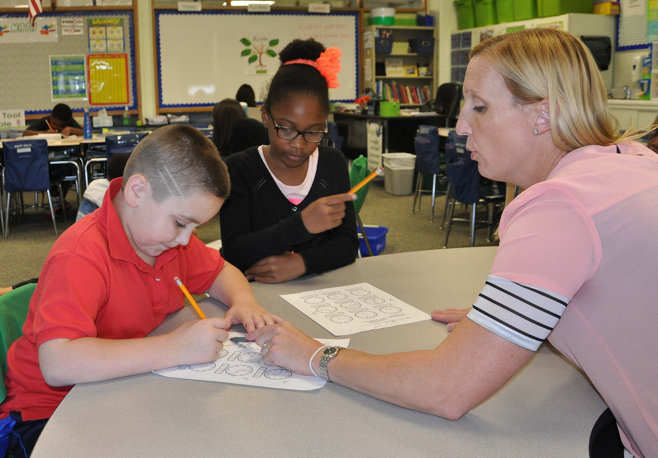 Master Teacher Amy Campbell helps current Conshohocken Elementary School third graders with a math exercise.