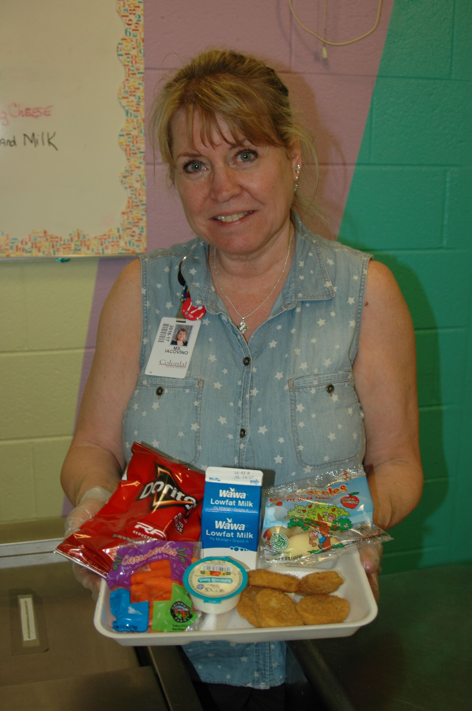 Colonial Elementary Head Cook Sharon Iacovino with a lunch. All meals include a protein, grain, fruits, vegetables and a milk per federal nutrition guidelines.