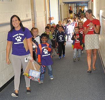 Kindergarten teachers walking lines of students to their classrooms on the first day of kindergarten.