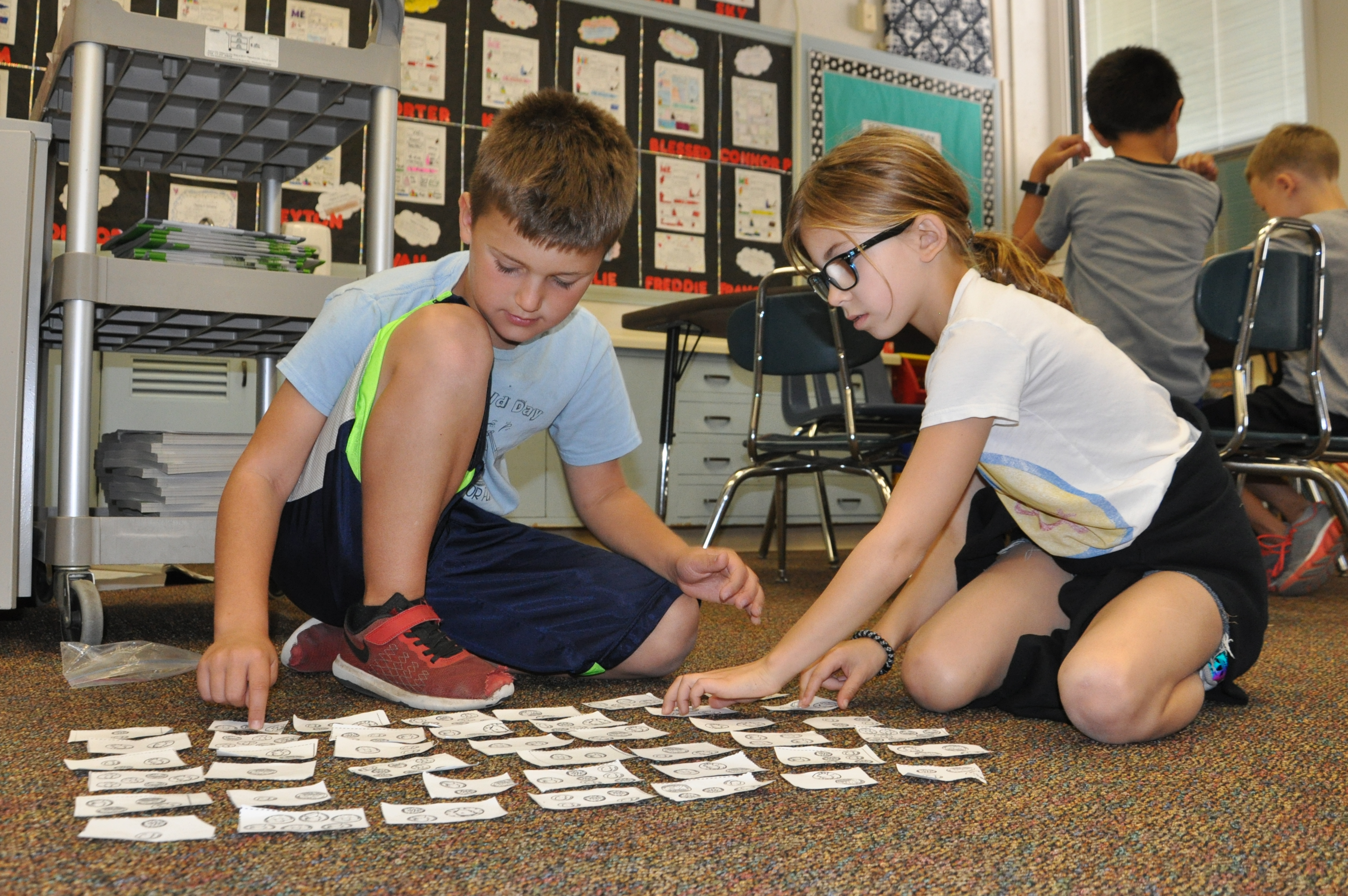 Current Whitemarsh Elementary School third graders collaborate on a math exercise