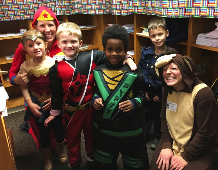 four children and two adults in costumes