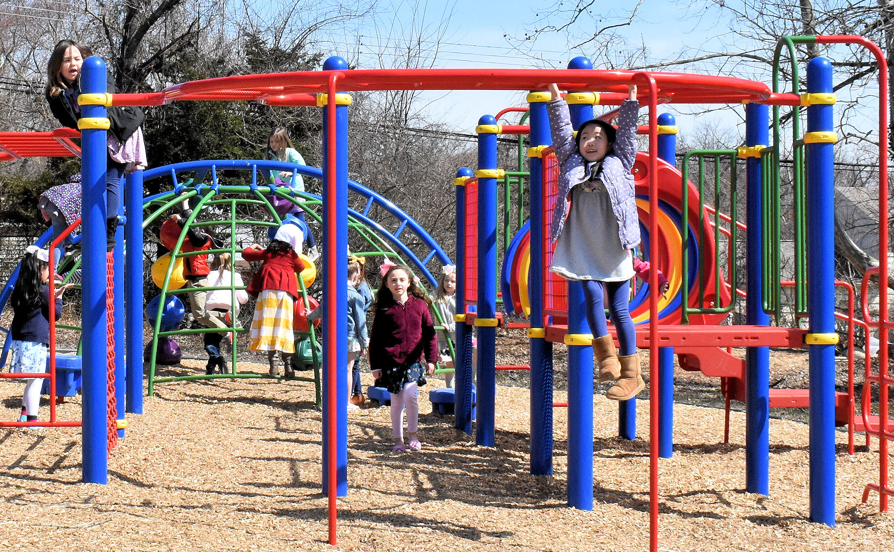 students playing on playground apparatus.