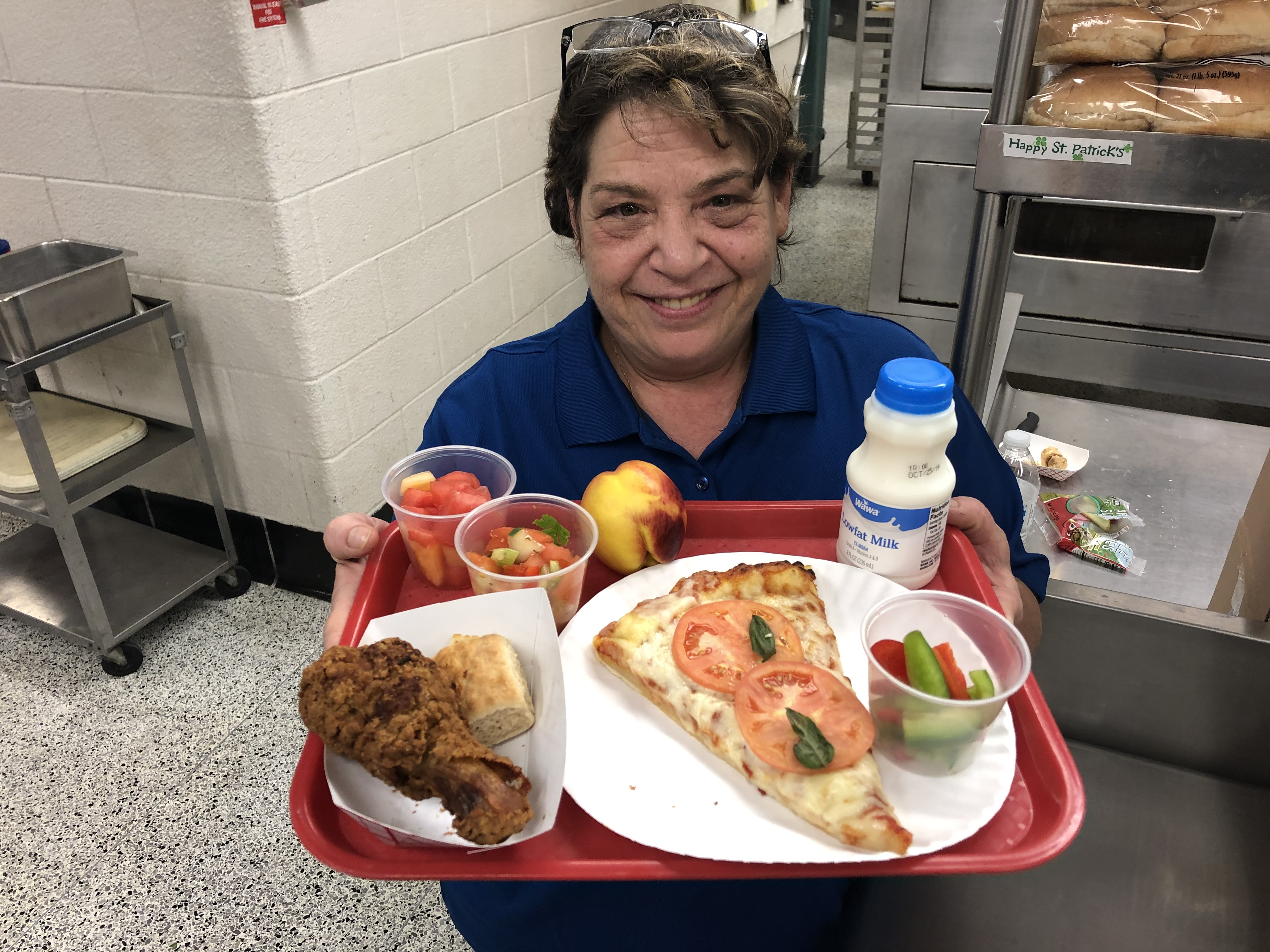 woman holding tray of food
