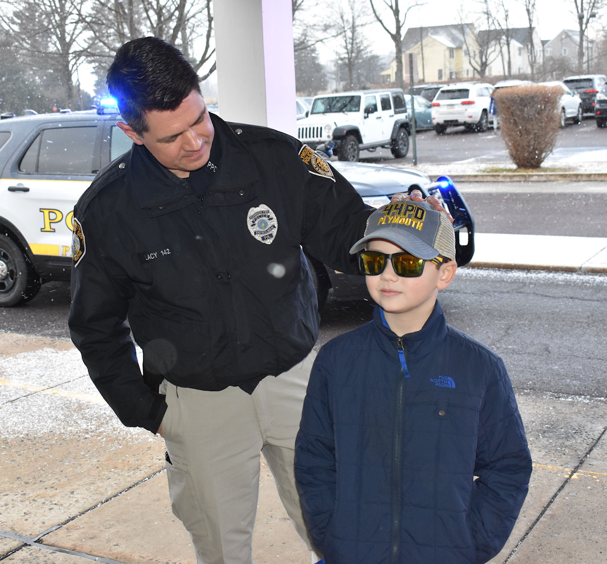 Police officer standing with student