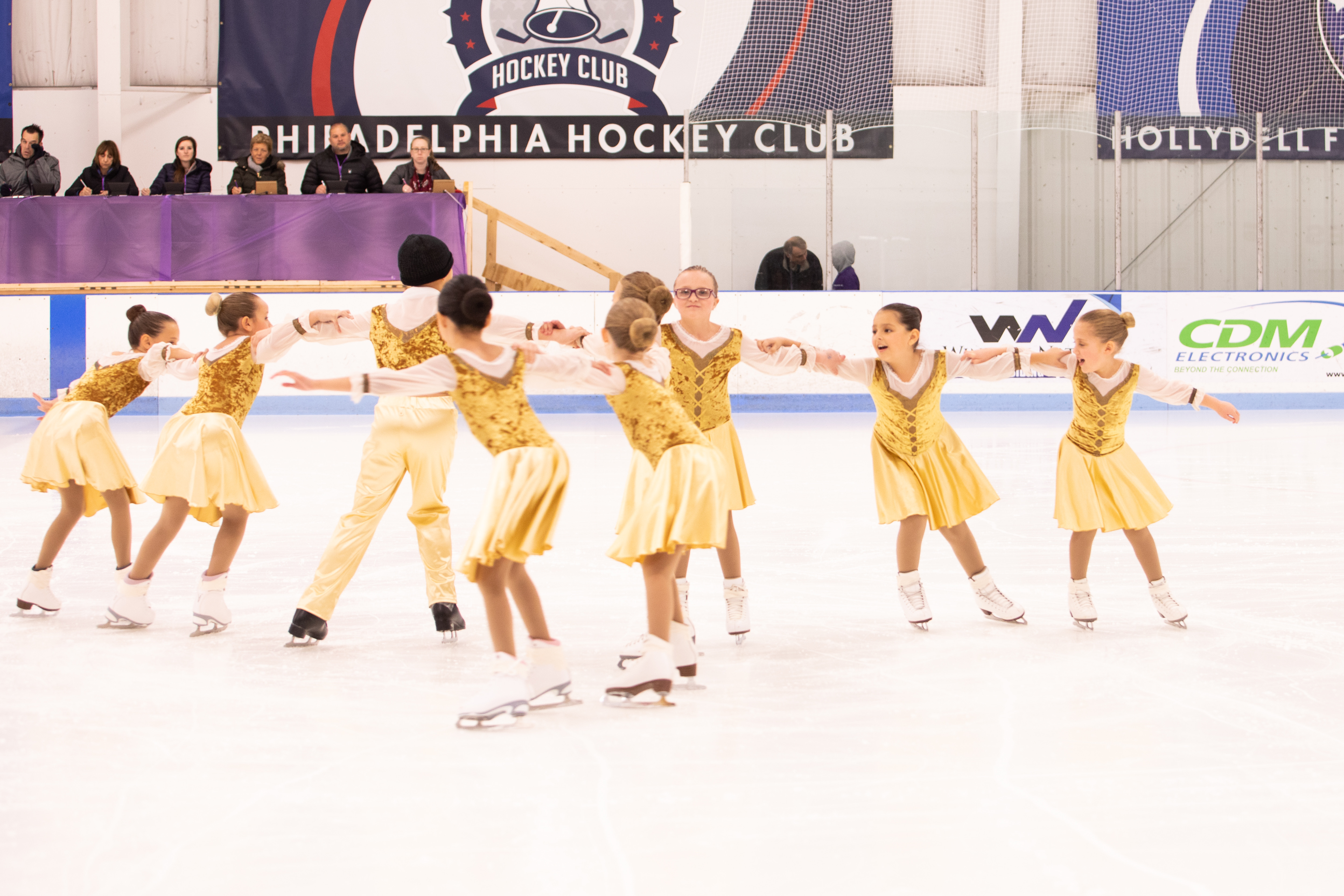 Nine skaters making a Y formation.