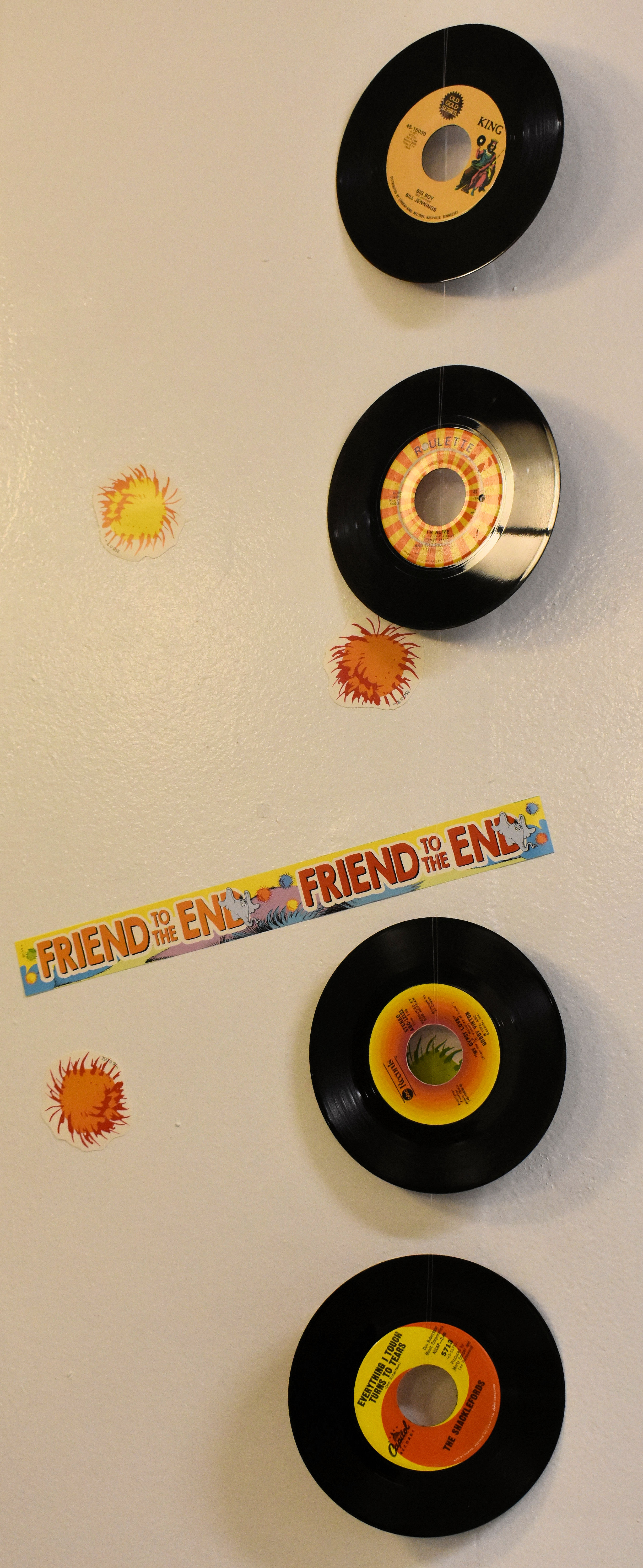 45 rpm records on a wall