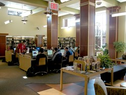 students at tables in the library