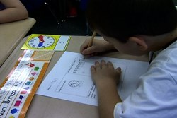 Second grade student doing a math worksheet