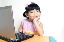 Girl on laptop at home