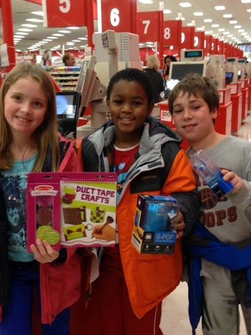 CES Cares members buying toys for needy neighbors