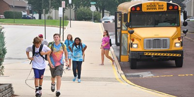 Students getting off of the bus at Colonial Middle School