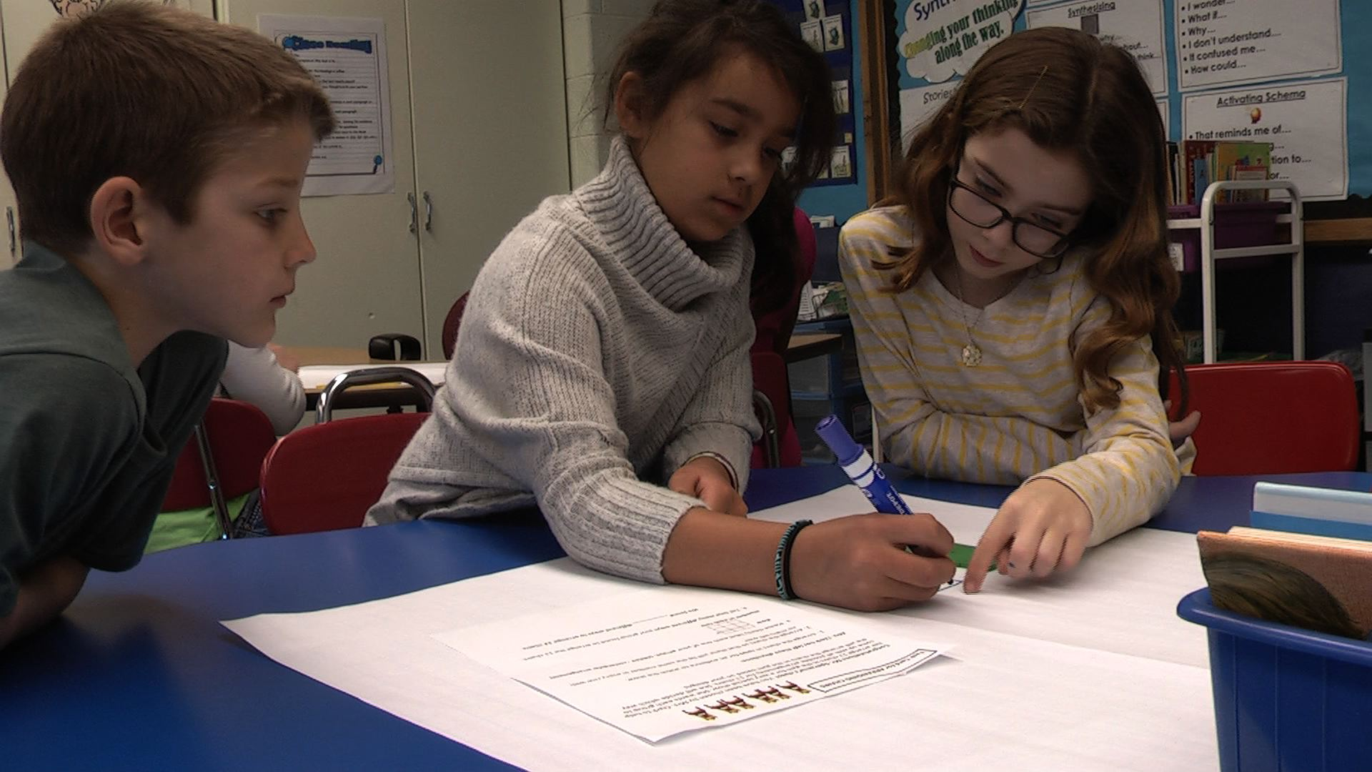 Students work together to complete different arrays in math class at Conshohocken Elementar