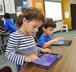 Two kindergarteners with tablets