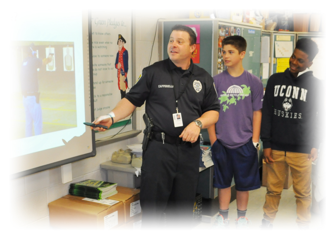 Police officer with two middle school boys at an interactive whiteboard
