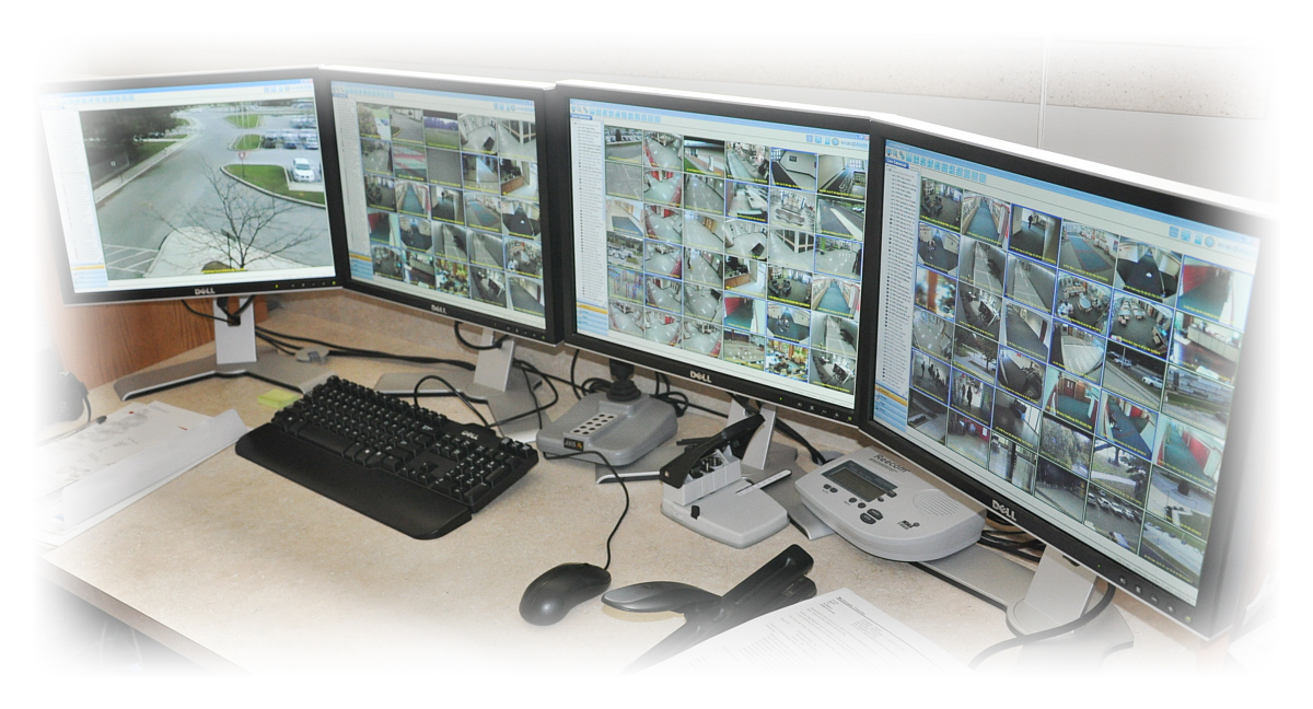 Four computer screens showing multiple security camera views