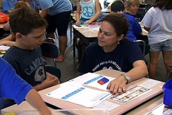 A Ridge Park teacher helps a student work through a math problem